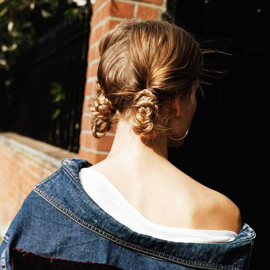 Twisted sista: A kooky combo of two fishtail braids and low knots - twisted together to form an updated up-do with undone charm.