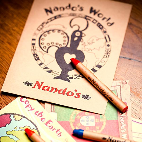 Nandos menu and kids crayons at the O2 Centre